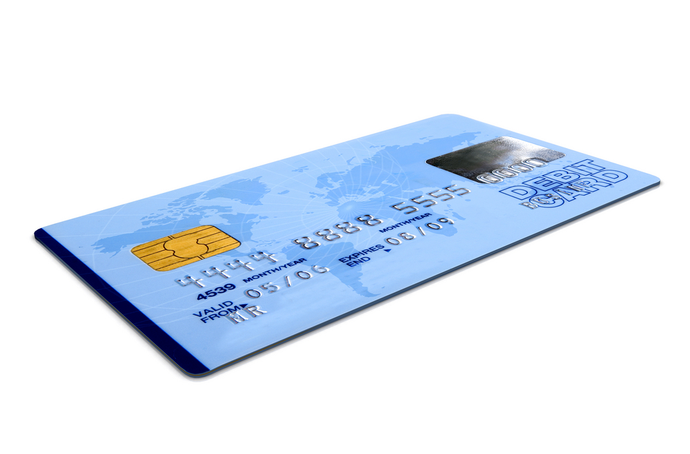 credit card over a white background - note the design of the card is my own and the numbers on the card are made up - perspective angle